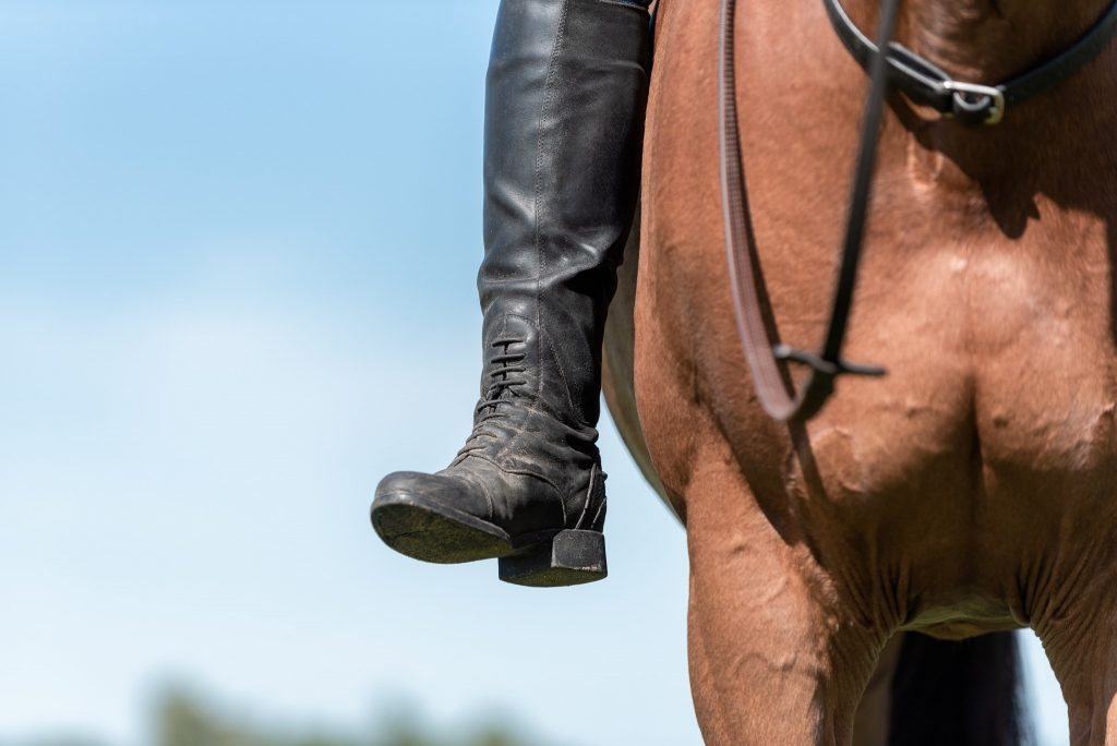 Heeled boot worn by mounted rider